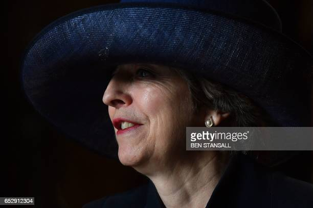 TOPSHOT British Prime Minister Theresa May leaves after attending a Commonwealth Day Service at Westminster Abbey in central London on March 13 2017...
