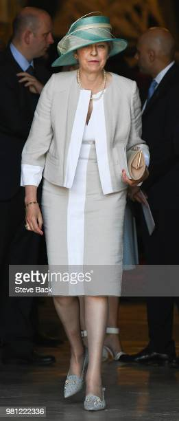 British Prime Minister Theresa May leaves after attending the Service of Thanksgiving to mark the 70th anniversary of the landing of the Empire...