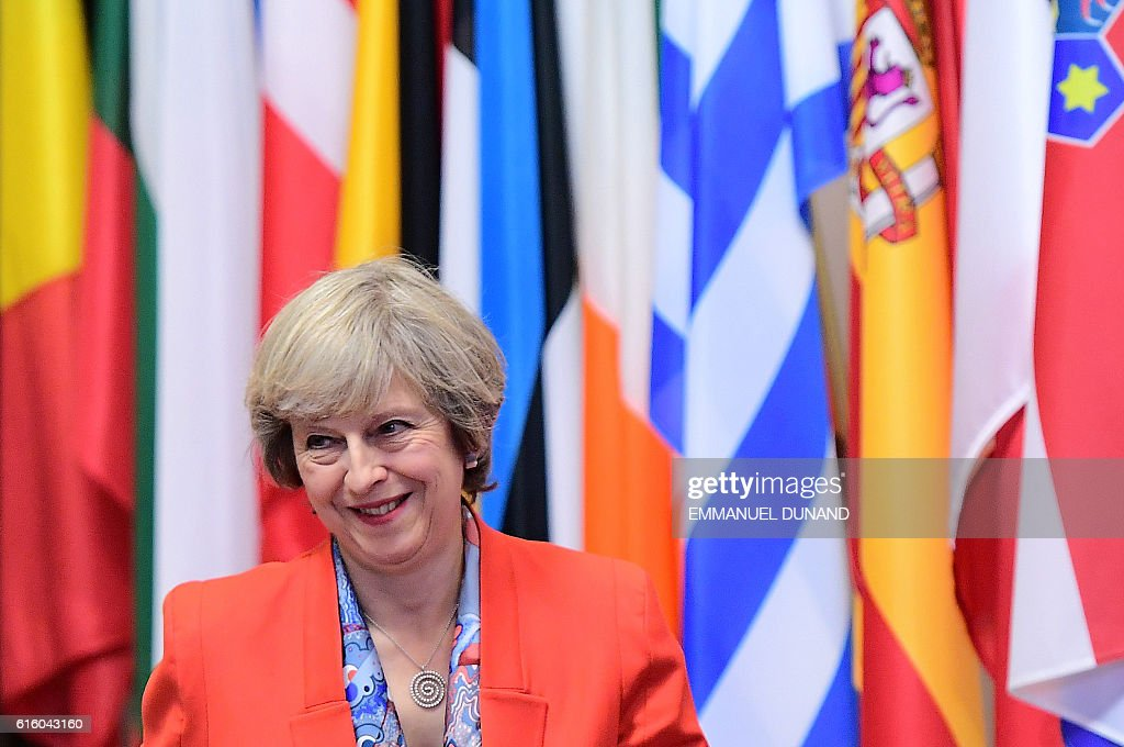 British Prime Minister Theresa May leaves at the end of an European Union leaders summit on October 21, 2016 at the European Council, in Brussels. / AFP / EMMANUEL