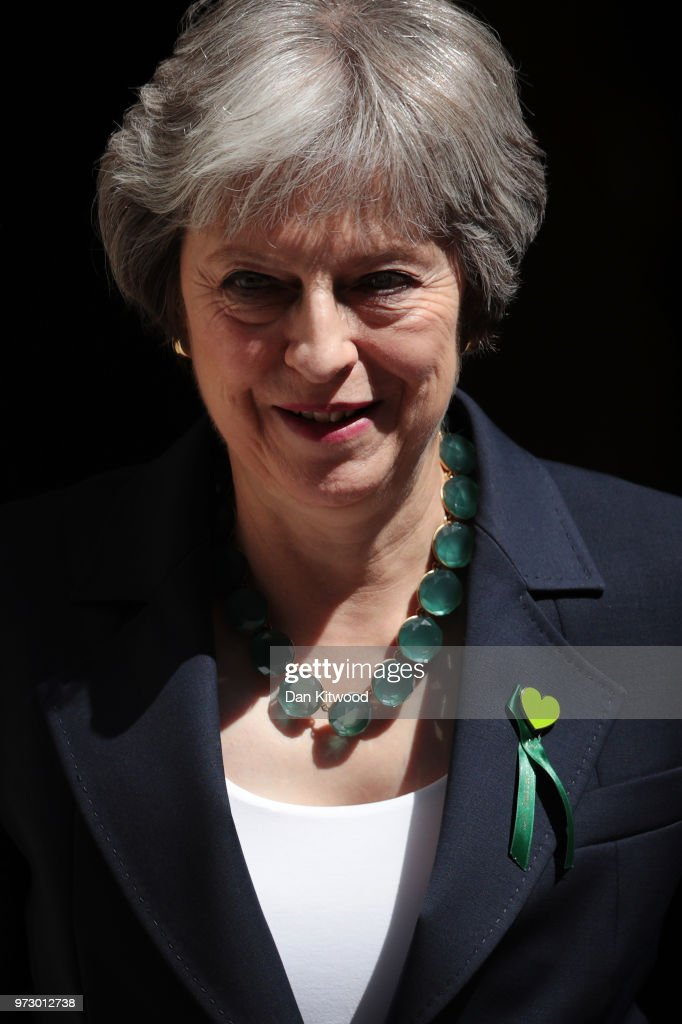 British Prime Minister Theresa May leaves Downing Street on June 13, 2018 in London, England. The Prime Minister will attend today the weekly Prime Ministers Questions in the House of Commons.