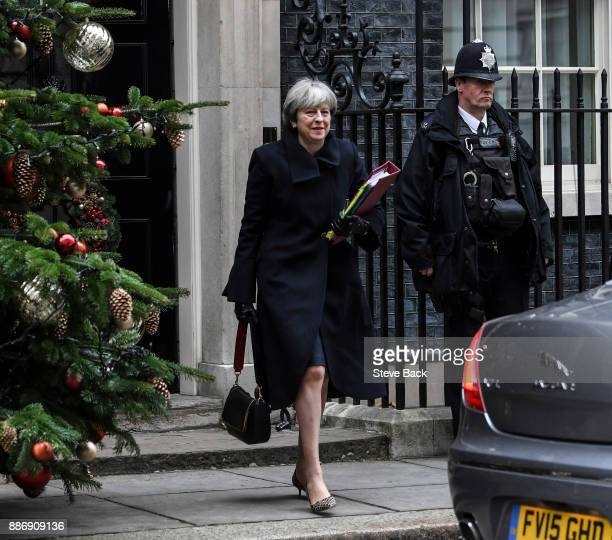 British Prime Minister Theresa May leaves for Prime Minister's Questions as she walks to a car in Downing Street on December 6 2017 in London England...