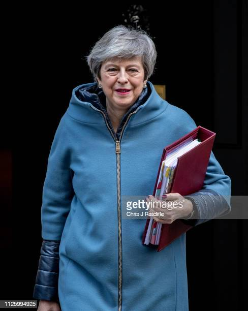 British Prime Minister Theresa May leaves for Prime Minister's Questions at the Houses of Parliament on February 20 2019 in London England MPs Anna...
