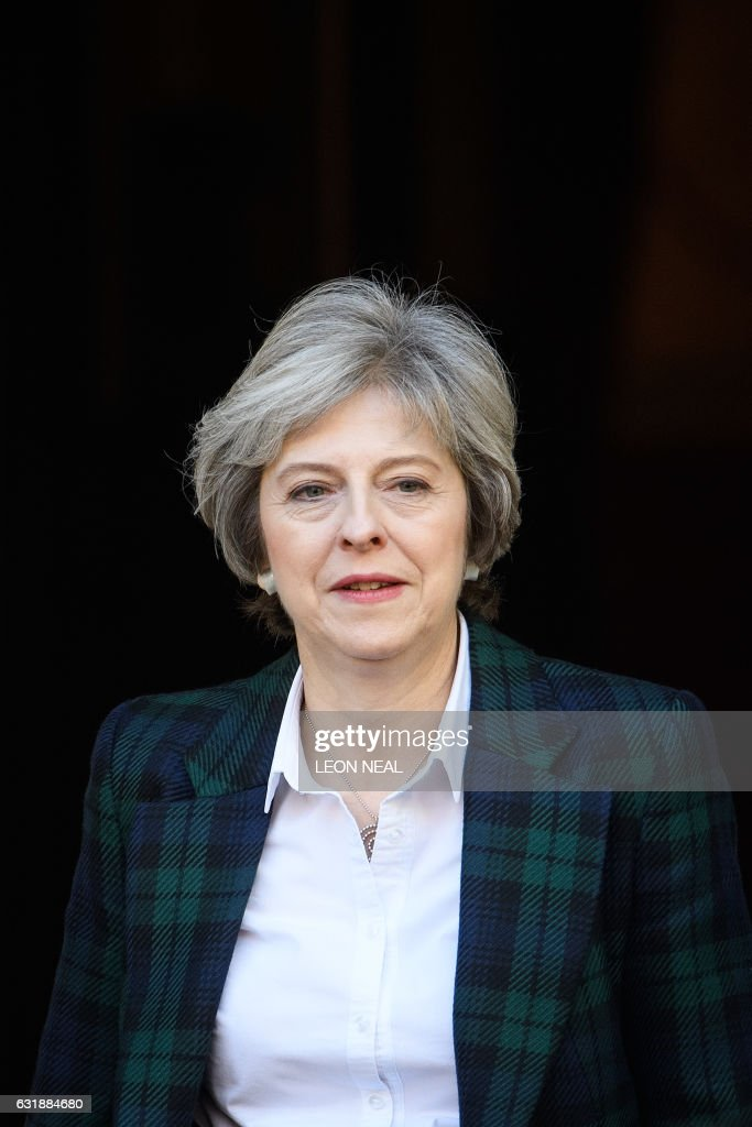 British Prime Minister Theresa May leaves Lancaster House in London on January 17, 2017, where she made a speech on the government's plans for Brexit. Prime Minister Theresa May on Tuesday said Britain will leave the EU's single market in order to restrict immigration in a clean break from the bloc, but lawmakers can vote on the final deal. / AFP / POOL / Leon Neal