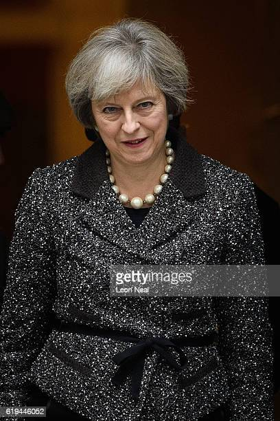 British Prime Minister Theresa May leaves number 10 ahead of a photocall for this years 'Poppy Appeal' at Downing Street on October 31 2016 in London...