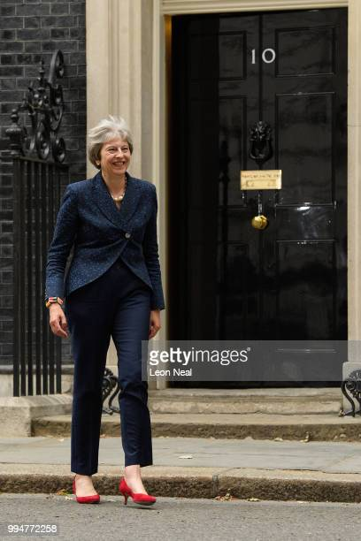 British Prime Minister Theresa May leaves number 10 as she greets the Austrian Chancellor Sebastian Kurz on July 9 2018 in London England