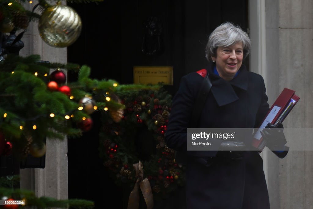 British Prime Minister Theresa May leaves number 10, Downing Street as she heads to the House of Commons for the weekly Prime Minister's Questions session on December 20, 2017 in London, England.