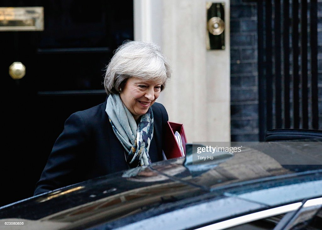 British Prime Minister Theresa May leaves Number 10, Downing Street on November 16, 2016 in London, England. Theresa May will be attending the PMQ's in which she will answer questions in regards to Brexit plans.