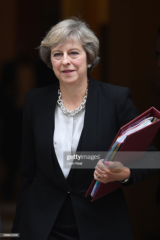 Theresa May Leaves For Prime Minister's Questions : News Photo