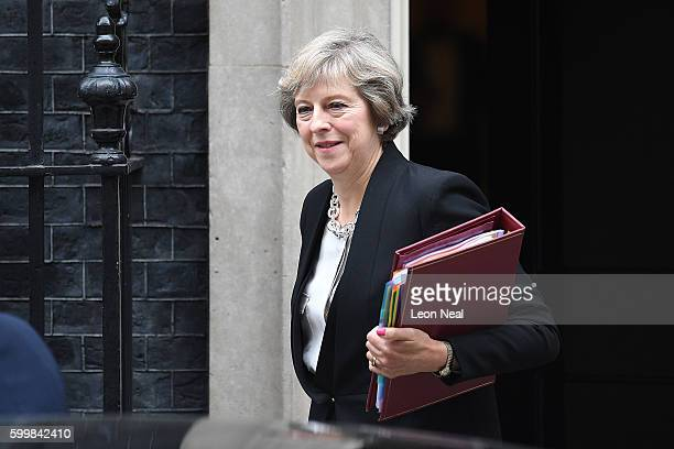 British Prime Minister Theresa May leaves number 10 Downing Street for Prime Minister's Questions in the House of Commons on September 7 2016 in...