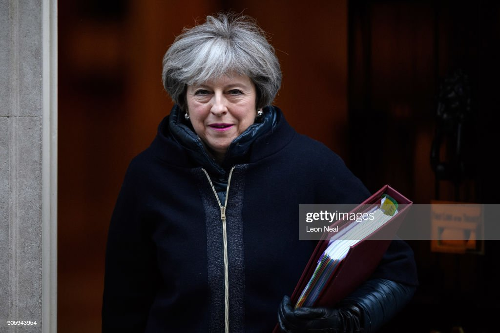 British Prime Minister Theresa May leaves number 10 Downing Street, ahead of the weekly PMQ session in the House of Commons on January 17, 2018 in London, England.