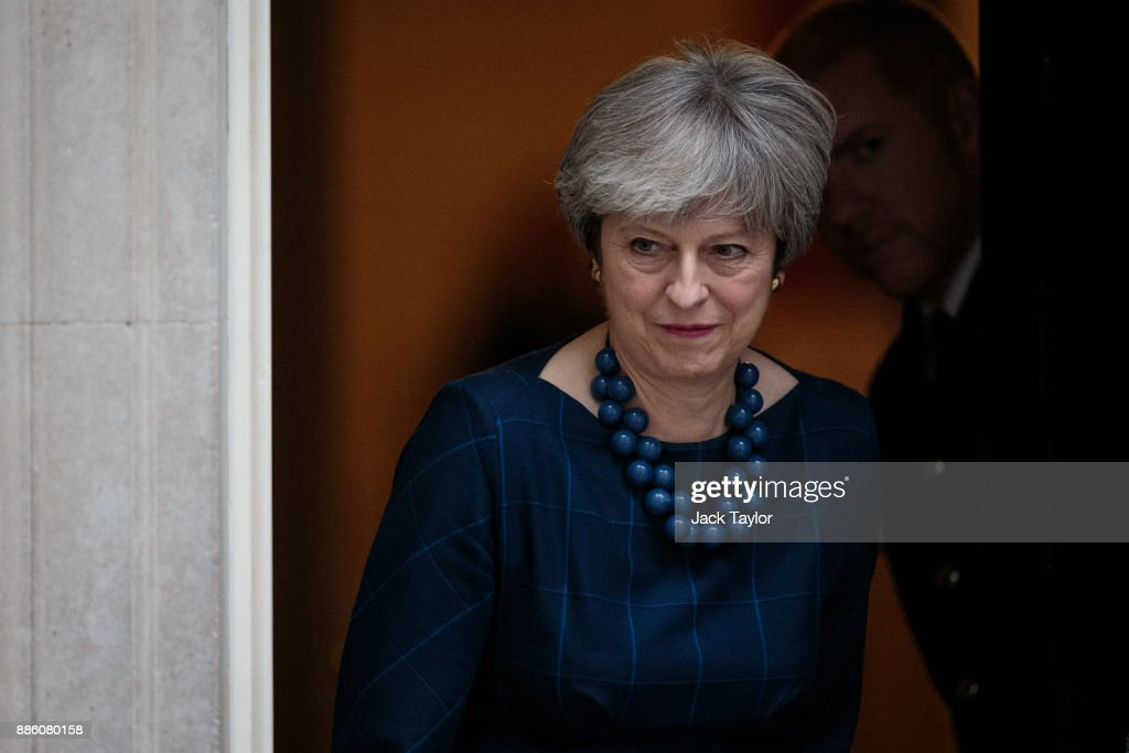 British Prime Minister Theresa May leaves Number 10 to greet Spanish Prime Minister Mariano Rajoy on Downing Street on December 5, 2017 in London, England. Mrs May and Mr Rajoy are expected to discuss the political situation in Catalonia and the ongoing Brexit negotiations.