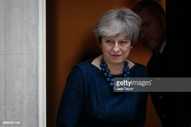 British Prime Minister Theresa May leaves Number 10 to greet Spanish Prime Minister Mariano Rajoy on Downing Street on December 5 2017 in London...