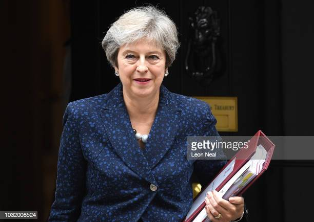 British Prime Minister Theresa May leaves number 11 Downing Street ahead of Prime Minister's Question session on September 12, 2018 in London,...