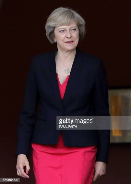 British Prime Minister Theresa May leaves Stormont Castle in Belfast Northern Ireland on July 25 2016 after a meeting with Northern Ireland's First...