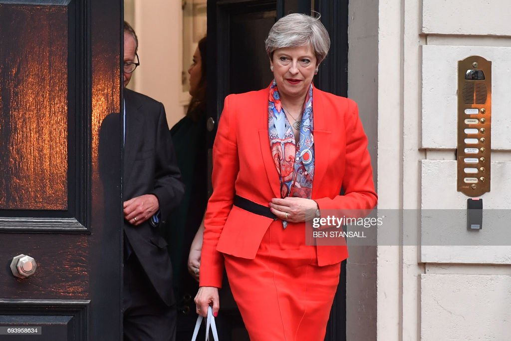 TOPSHOT - British Prime Minister Theresa May leaves the Conservative Party HQ in central London, on June 9, 2017, hours after the polls closed in the British general election. Prime Minister Theresa May's Conservatives are set to lose their overall majority after Britain's general election, an exit poll showed on Thursday after voting closed. / AFP PHOTO / Ben STANSALL