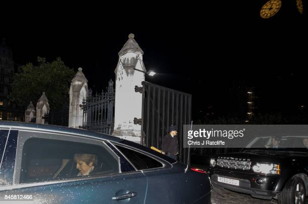 British Prime Minister Theresa May leaves the Houses of Parliament by car after the vote on the EU Withdrawal Bill on September 12 2017 in London...