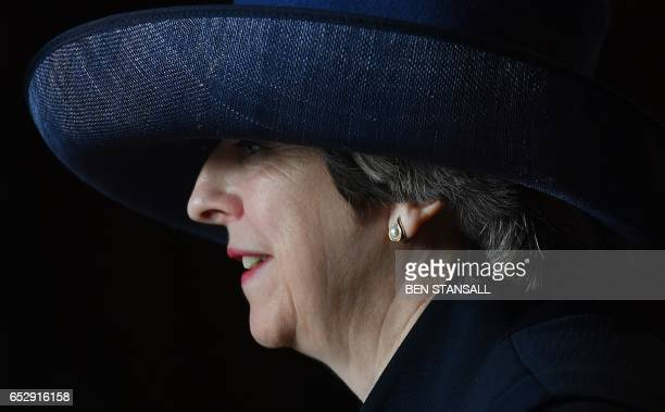 British Prime Minister Theresa May leaves Westminster Abbey in central London on March 13 after attending a Commonwealth Day Service Queen Elizabeth...