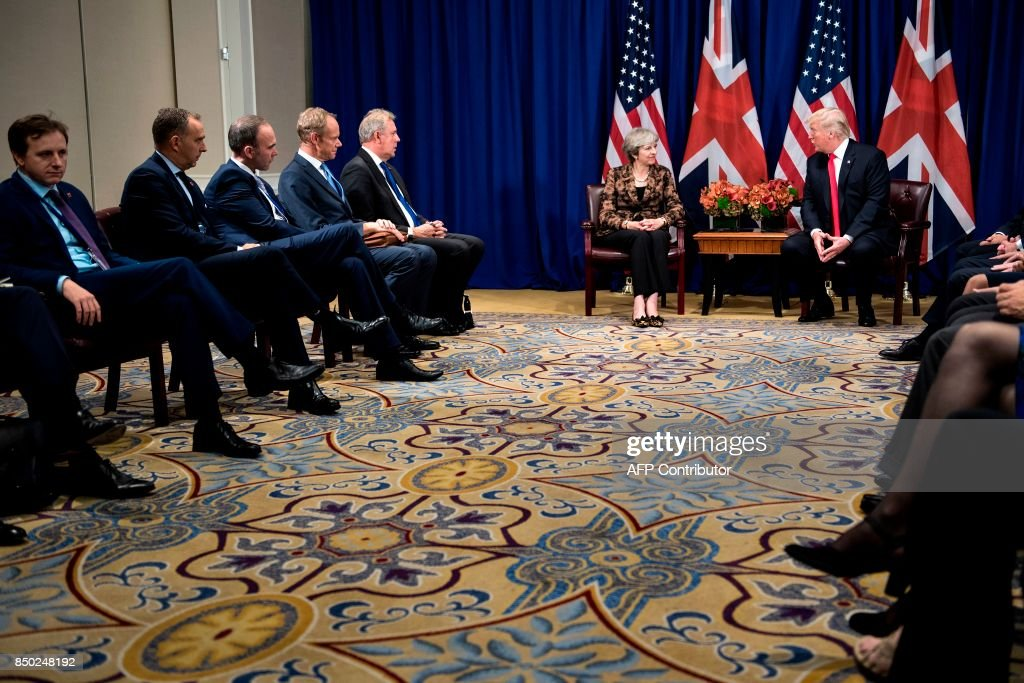 British Prime Minister Theresa May (C) listens as US President Donald Trump (R) makes a statement for the press before a meeting at the Palace Hotel in New York, on the sidelines of the 72nd United Nations General Assembly, on September 20, 2017. / AFP PHOTO / Brendan Smialowski