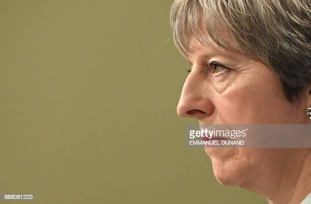 British Prime Minister Theresa May looks on as she addresses a press conference with the European Commission president at the European Commission in...
