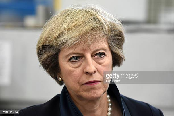 British Prime Minister Theresa May looks on during a visit to the Warwick Manufacturing Group facility at the University of Warwick on September 1...
