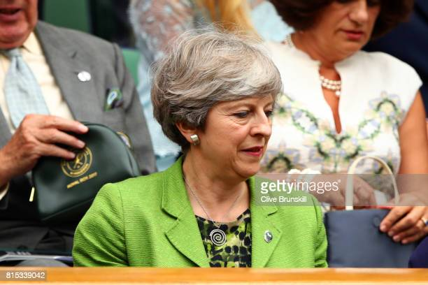 British Prime Minister Theresa May looks on from the centre court royal box prior to the Gentlemen's Singles final between Roger Federer of...