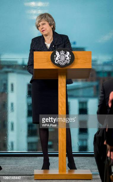 British Prime Minister Theresa May makes a speech during a visit to Allstate Northern Ireland on February 5 2019 in Belfast Northern Ireland Mrs...