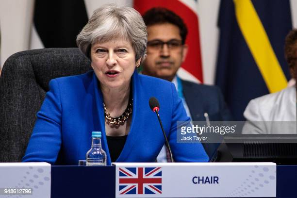 British Prime Minister Theresa May makes the opening statement as Commonwealth leaders attend the first executive session of the 'Commonwealth Heads...