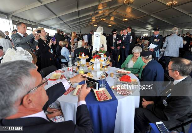 British Prime Minister Theresa May meets DDay veterans at a veterans reception during the National Commemorative Event commemorating the 75th...