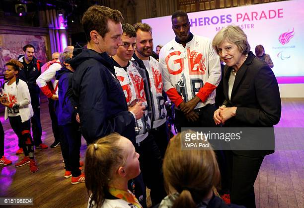 British Prime Minister Theresa May meets Ellie Simmonds Ellie Robinson Alistair Brownlee Jonny Brownlee Aled Davies and Lutalo Muhammad of Great...