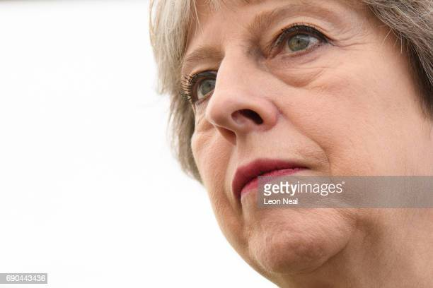 British Prime Minister Theresa May meets people as she walks around the Royal Bath and West Show on May 31 2017 in Shepton Mallet United Kingdom...