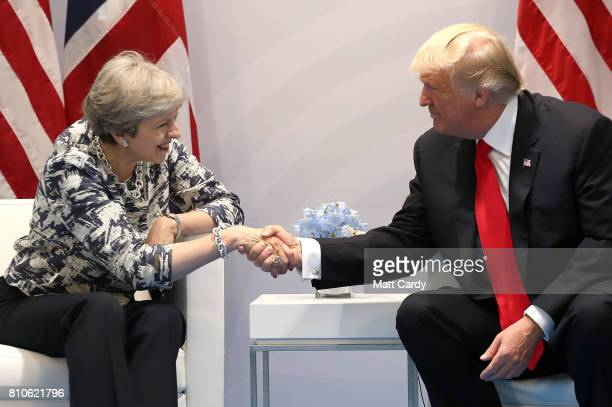 British Prime Minister Theresa May meets US President Donald Trump during the G20 summit on July 8 2017 in Hamburg Germany Leaders of the G20 group...