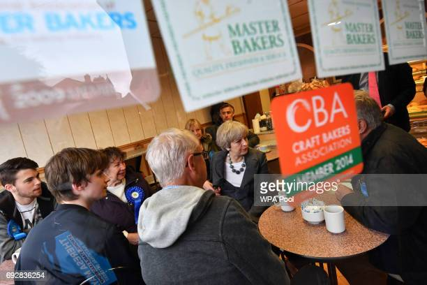 British Prime Minister Theresa May meets with Conservative party supporters during an election campaign visit to a bakery during an election campaign...