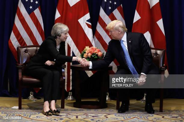 TOPSHOT British Prime Minister Theresa May meets with US President Donald Trump September 26 2018 on the sidelines of the United Nations General...