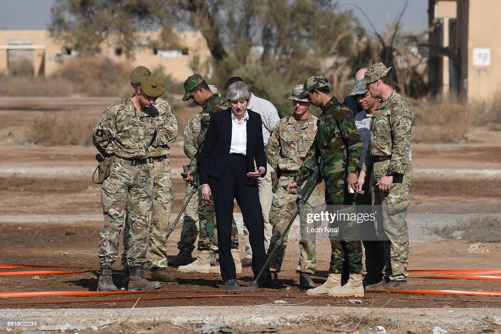 British Prime Minister Theresa May observes a team of Iraqi security forces as they are trained with metal detectors at the Camp Taji military base on November 29, 2017 in Taji, Iraq. Theresa May has made a surprise visit to Iraq during a planned visit to the Middle East.