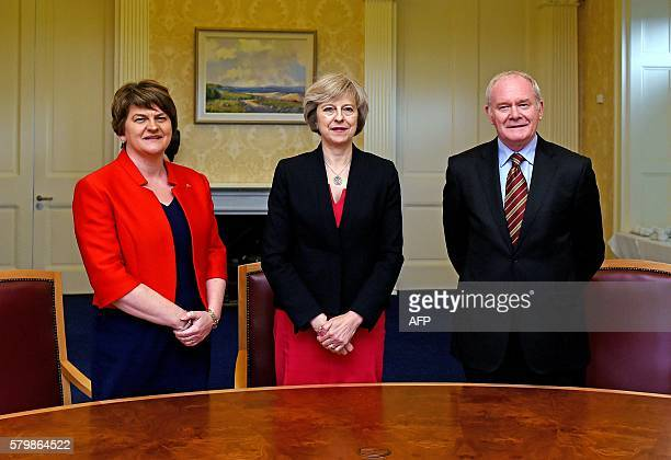 British Prime Minister Theresa May poses for a picture with Northern Ireland's First Minister Arlene Foster and Deputy First Minister Martin...