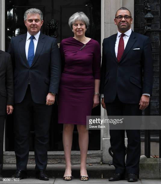 British Prime Minister Theresa May poses outside 10 Downing street with newly appointed chairman of the Conservative Party Brandon Lewis and deputy...