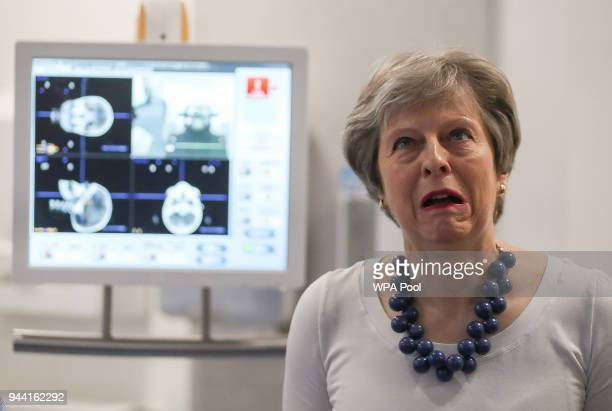 British Prime Minister Theresa May reacts during a visit to announce new funding and research into prostate cancer at Addenbrooke's Hospital on April...