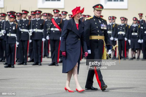 British Prime Minister Theresa May representing Britain's Queen Elizabeth II views the cadets with General Paul Nanson during the Sovereign's Parade...