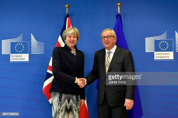 British Prime Minister Theresa May shakes hands with European Commission chief JeanClaude Juncker prior to a Brexit negotiation meeting on December 4...