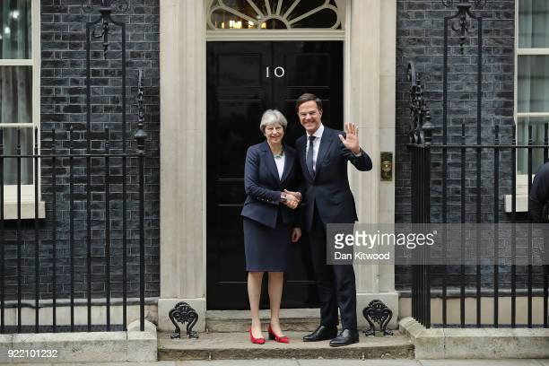 British Prime Minister Theresa May shakes hands with Prime Minister of the Netherlands Mark Rutte outside Downing Street on February 21 2018 in...