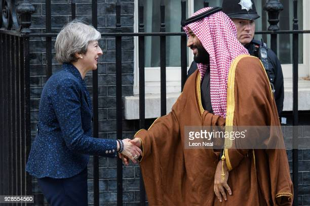 British Prime Minister Theresa May shakes hands with Saudi Crown Prince Mohammed bin Salman on the steps of number 10 Downing Street on March 7 2018...