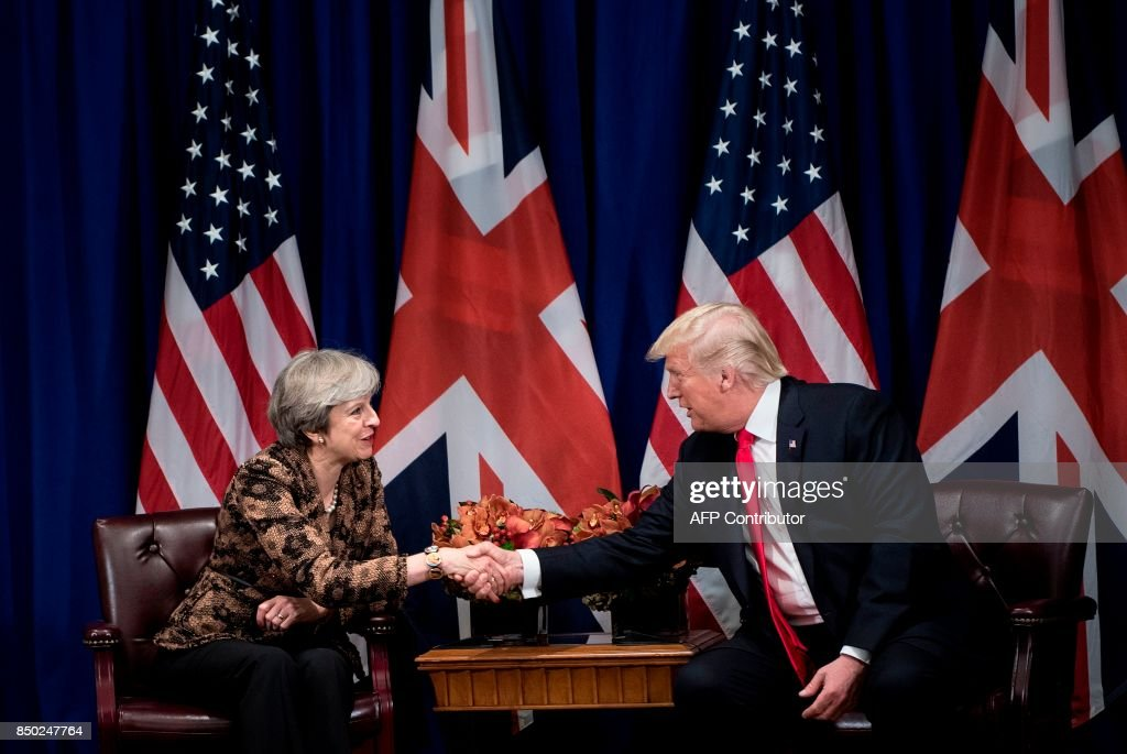 British Prime Minister Theresa May shakes hands with US President Donald Trump during their meeting at the Palace Hotel in New York City, on the sidelines of the 72nd United Nations General Assembly, on September 20, 2017. / AFP PHOTO / Brendan Smialowski