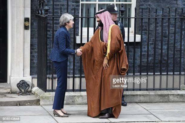 British Prime Minister Theresa May shankes hands with Saudi Crown Prince Mohammed bin Salman on the steps of number 10 Downing Street on March 7 2018...
