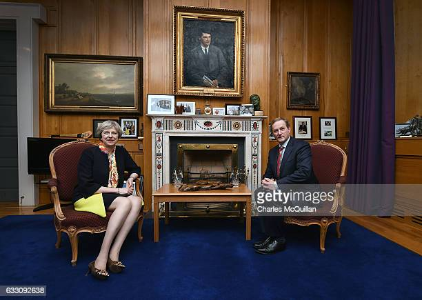 British Prime Minister Theresa May sits beside Irish Taoiseach Enda Kenny in his office at Government Buildings on January 30 2017 in Dublin Ireland...