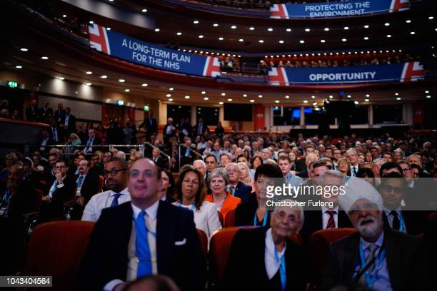 British Prime Minister Theresa May sits in the audience during the annual Conservative Party Conference on September 30, 2018 in Birmingham, England....