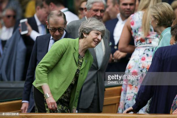 British Prime Minister Theresa May sits in the Royal box on Centre Court for the men's singles final match on the last day of the 2017 Wimbledon...