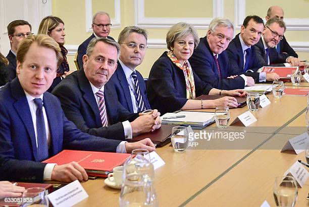 British Prime Minister Theresa May sits with colleagues British Paymaster General and Minister for the Cabinet Office Ben Gummer British...