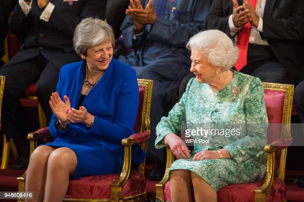 British Prime Minister Theresa May sits with Queen Elizabeth II at the formal opening of the Commonwealth Heads of Government Meeting in the ballroom...