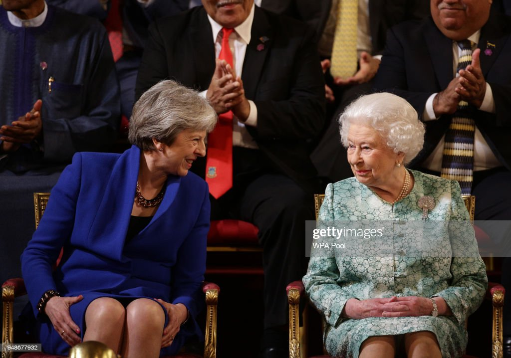 British Prime Minister Theresa May sits with Queen Elizabeth II attend the formal opening of the Commonwealth Heads of Government Meeting (CHOGM) in the ballroom at Buckingham Palace on April 19, 2018, in London, England.