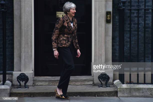 British Prime Minister Theresa May smiles as she leaves 10 Downing Street to greet New Zealand's Prime Minister Jacinda Ardern in central London on...
